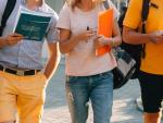 free-time-of-students-bachelor-s-campus-life-rhythm-five-friendly-students-are-walking