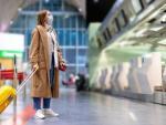 Turismo turista maleta coronavirus mascarilla España