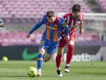Lionel Messi, del Barcelona, en acción durante el juego contra el Atlético de Madrid.