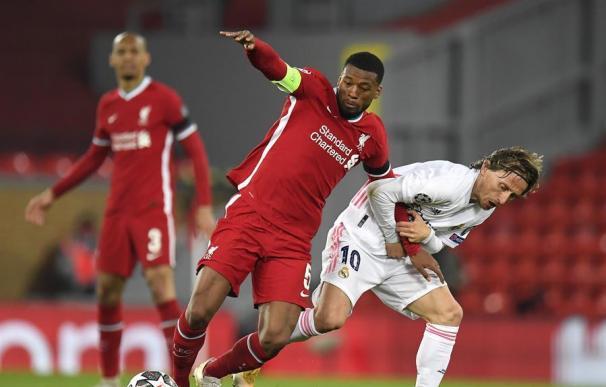 Liverpool's Georginio Wijnaldum (C) in action against Real Madrid's Luka Modric