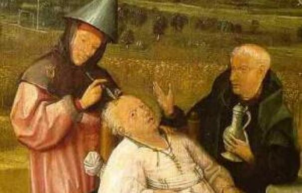Un cirujano extrae la piedra de la locura. Cuadro de El Bosco.