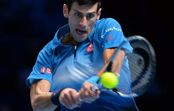 Djokovic ve extraño que su amigo Ljubicic entrene a Federer / AFP