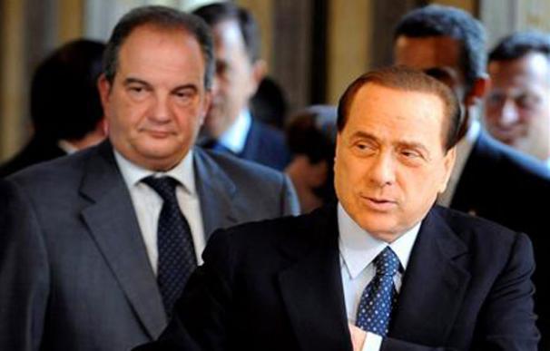 Silvio Berlusconi (d), primer ministro de Italia