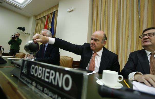 Guindos dice que la venta combinada de Bankia y BMN permitiría al FROB capturar dos tercios de las sinergias