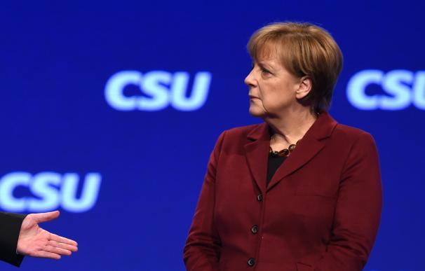 German Chancellor Angela Merkel follows the speech