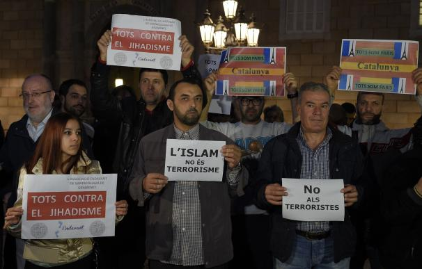 """People show posters reading """"Islam is not terroris"""