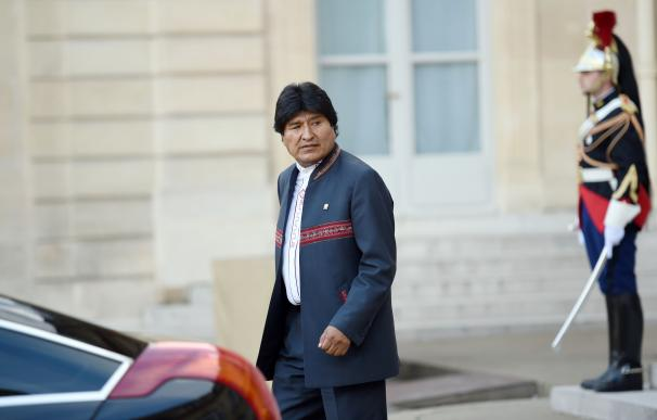 Bolivian President Evo Morales leaves after his me