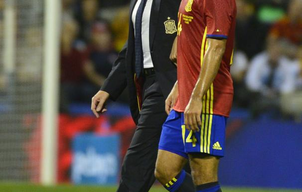 Spain's midfielder Thiago (R) leaves the pitch due