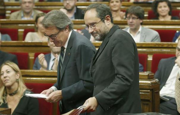Artur Mas y Antonio Baños, de la CUP, en el debate de investidura, en noviembre.