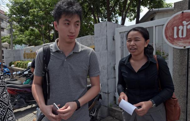Hong Kong photojournalist Anthony Kwan Hok-chun (L
