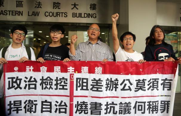 Hong Kong pro-democracy activists (L-R) Nathan Law