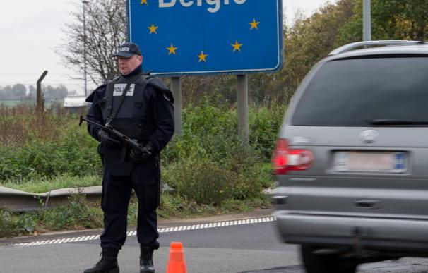 A police officer patrols at the France-Belgium bor