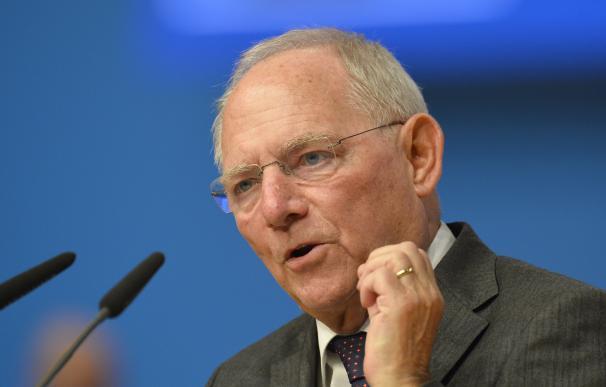 German Finance Minister Wolfgang Schaeuble talks t