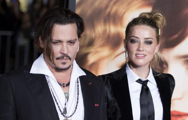 Actors Johnny Depp (L) and Amber Heard attend the