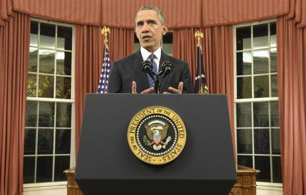 TOPSHOT - US President Barack Obama speaks during