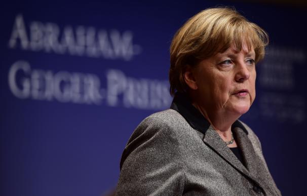 German Chancellor Angela Merkel addresses guests a