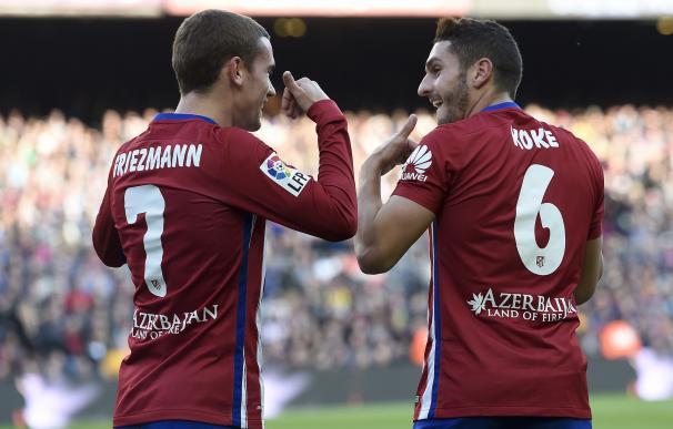 Atletico Madrid's midfielder Koke (R) celebrates w