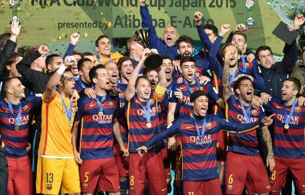 FC Barcelona captain Andres Iniesta (C) raises FIF