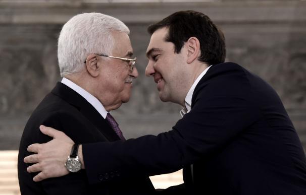 Greek prime minister Alexis Tsipras (R) hugs Pales