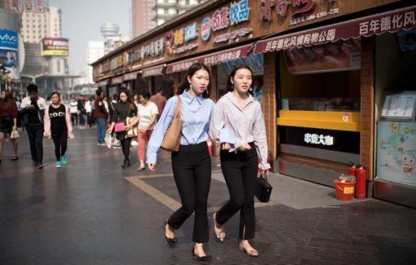 El PIB chino se desacelera en su transición a una economía de consumo, según el FMI