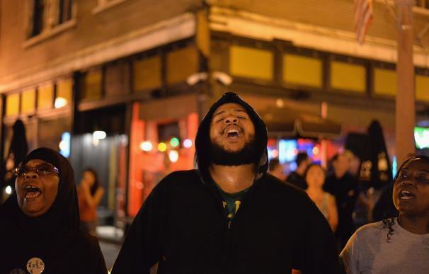 ST. LOUIS, MO - AUGUST 20: Demonstrators chant alo