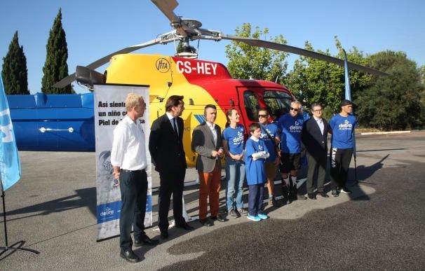Una ascensión a la Concha de Marbella conmemora el primer aniversario del Banco Solidario Piel de Mariposa