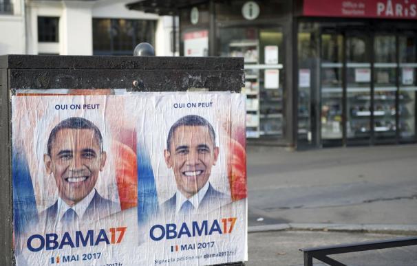 Los carteles que piden a Obama ser presidente de Francia, esta semana, en París.