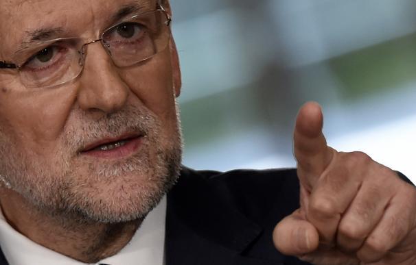 Spanish Prime Minister Mariano Rajoy gestures duri