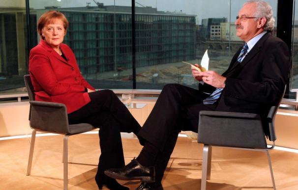 La canciller alemana ve el euro ante un examen histórico y exige a Grecia que cumpla su deber
