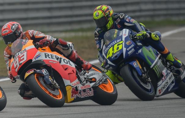 Repsol Honda Team's Spanish rider Marc Marquez (L)