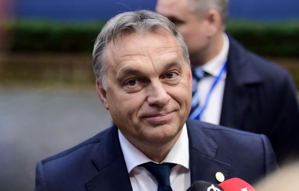 Hungarian Prime Minister Viktor Orban arrives to t