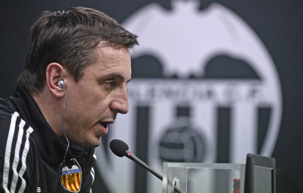 Valencia's British coach Gary Neville speaks durin