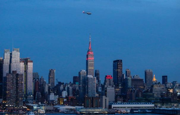The Empire State Building light up in red and gold