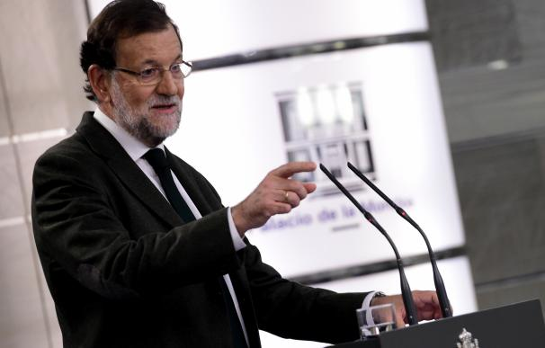 Spanish Prime Minister Mariano Rajoy holds a press