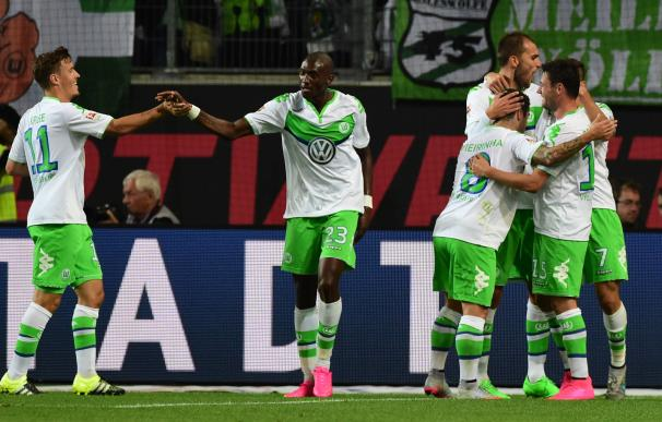 Wolfsburg players celebrate after Wolfsburg's Dutc
