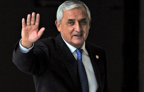 Guatemalan President Otto Perez waves at the end o