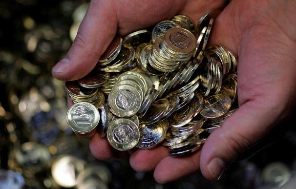 El euro sube hasta 1,2318 dólares a mediodía