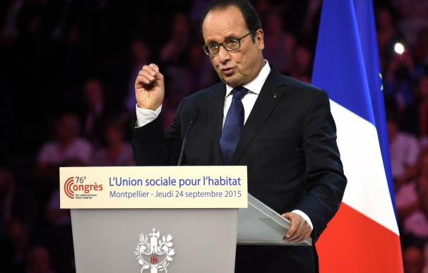 French president Francois Hollande delivers a spee