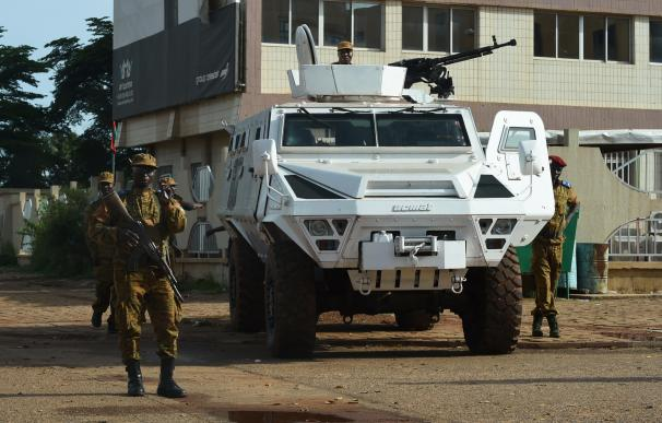 Burkina Faso army troops stand guard outside Guill