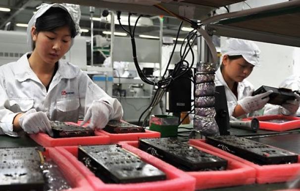 Empleados de Foxconn, el principal fabricante de productos Apple.