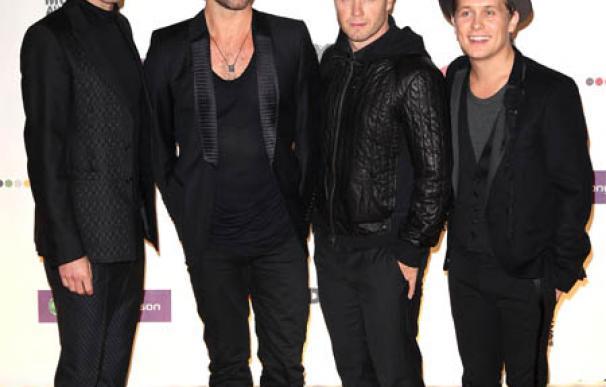 Robbie Williams podría permanecer con Take That tras su gira de verano