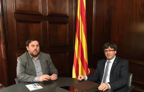 Oriol Junqueras y Carles Puigdemont.