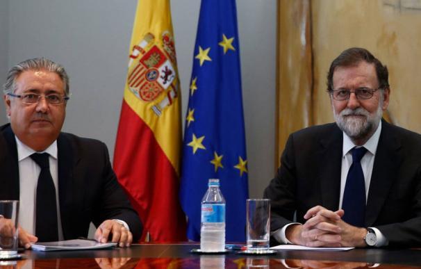 El presidente del Gobierno, Mariano Rajoy y el ministro del Interior, Juan Ignacio Zoido