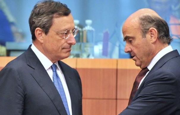 Mario Draghi y Luis de Guindos.