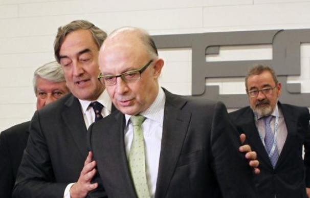 Cristóbal Montoro y Juan Rosell