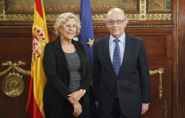 Manuela Carmena y Cristobal Montoro
