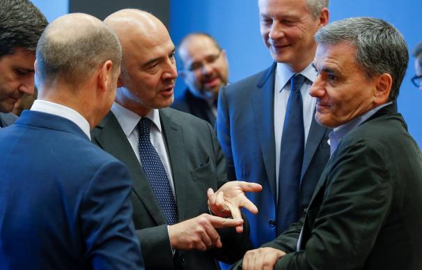 El ministro de Finanzas alemán, Olaf Scholz; el comisario europeo de Asuntos Económicos, Pierre Moscovici; el ministro francés Bruno Le Maire y el griego Euclid Tsakalotos