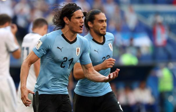 Edison Cavani celebra el tercel gol de los charrúas. /EFE