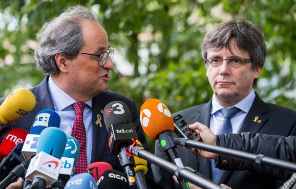 Torra y Puigdemont atienden a los medios en Waterloo.