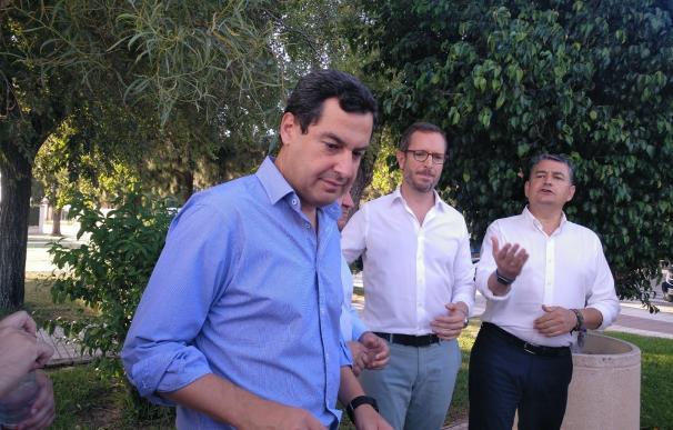 Juanma Moreno con Javier Maroto y Antonio Sanz